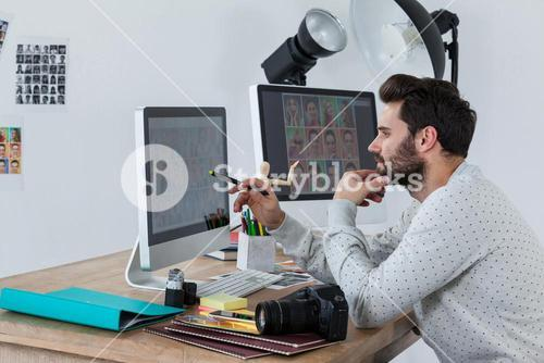 Photographer working on desktop pc