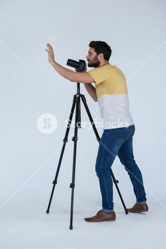 Photographer clicking picture using digital camera