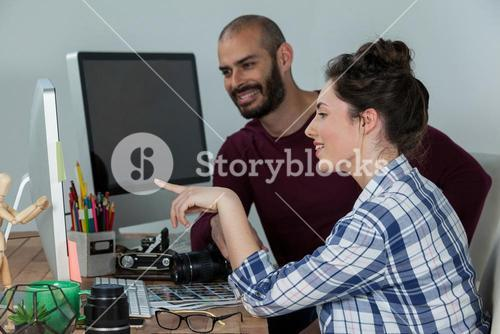 Photographers working at desk