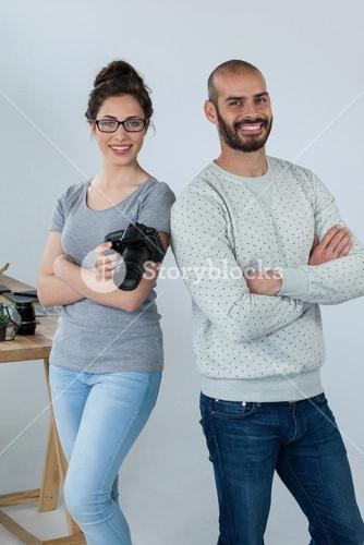 Photographers with digital camera standing in studio