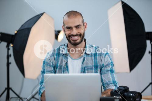Photographer working over laptop