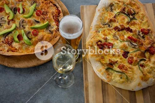 Italian pizza served with a beer glass