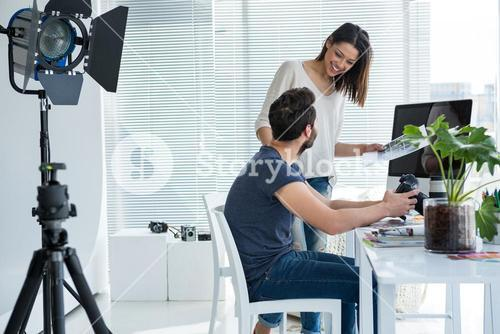 Photographers working together at desk