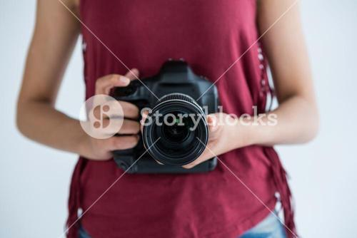 Mid section of female photographer