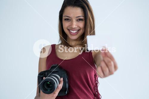 Female photographer showing visiting card in studio
