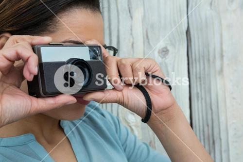 Female photographer with old fashioned camera