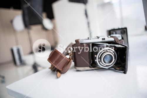 Close-up of old fashioned camera on table