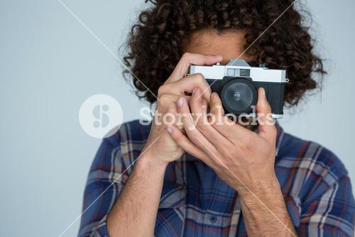 Male photographer with old fashioned camera