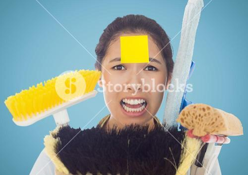 Frustrate woman with sticky notes stick on forehead holding cleaning equipment