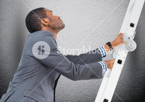 Businessman climbing a ladder against grey background