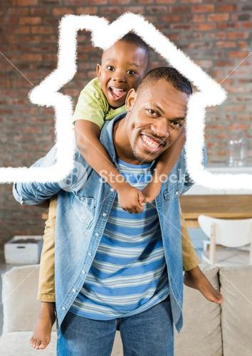 Man carrying his son on his shoulder against house outline in background