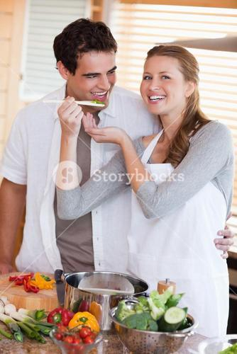 Couple enjoys preparing dinner together