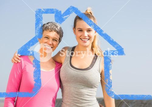 Mother and daughter standing outdoors against house outline in background