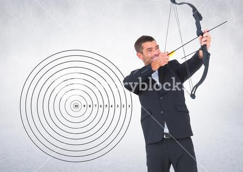 Businessman aiming at the target board against grey background