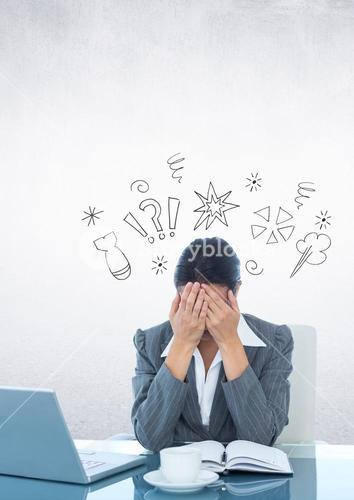 Businesswoman sitting on her desk with hands on her face against thinking icons in background