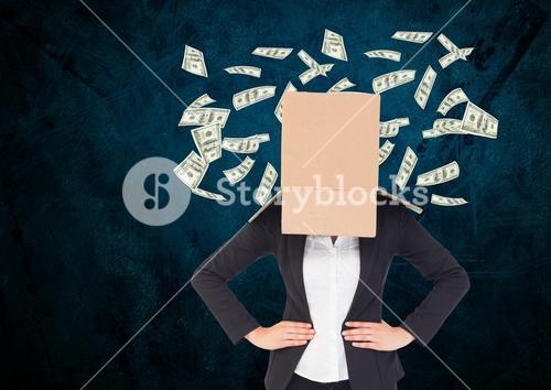 Businesswoman with her face cover with cardboard box standing against dollars flying in background