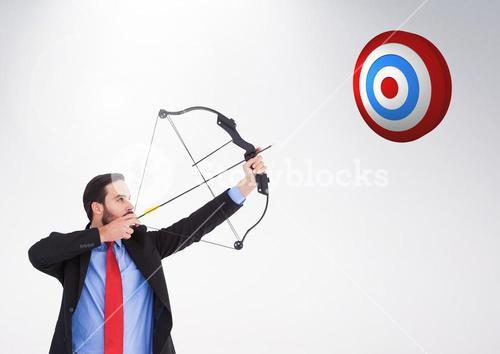 Businessman aiming at the target board against white background