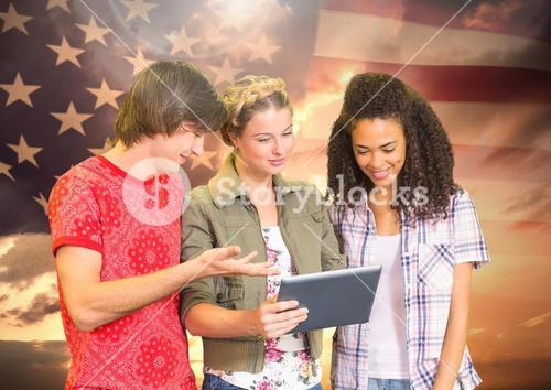 Students using tablet against american flag