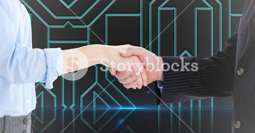 Business executives shaking hands against technology background