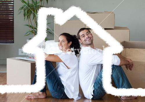 Couple sitting in living room against house outline in background