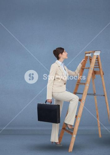 Businesswoman with briefcase climbing on step ladder