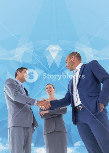 Business professionals shaking hands against abstract background