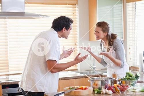 Couple having a fight in the kitchen