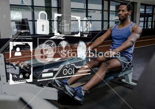 Fit man performing seated row exercise in gym against fitness interface in background