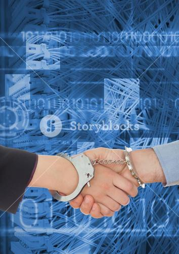 Business professionals shaking hands in handcuffs against coding background
