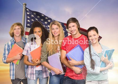 Friends with books standing against american flag in background