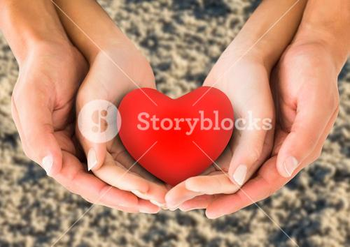 Couple holding heart shape in cupped hands