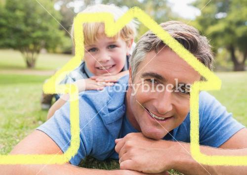 Father and son overlaid with house shape lying in park