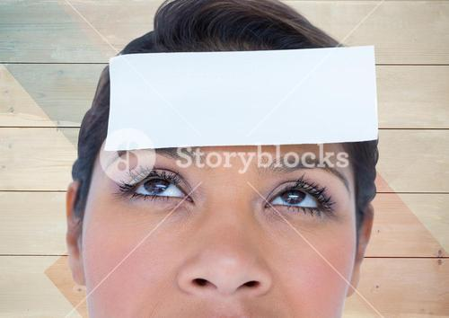 Woman with blank sticky note on forehead