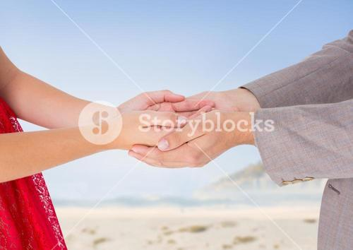 Man holding cupped hands of woman