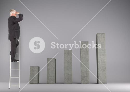 Businessman standing on ladder and looking at bar chart