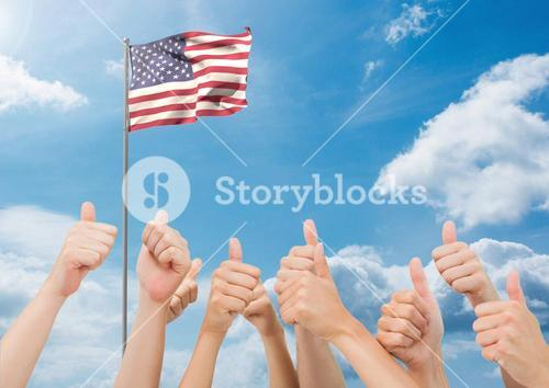 American flag flapping in sky and hands showing thumbs up sign