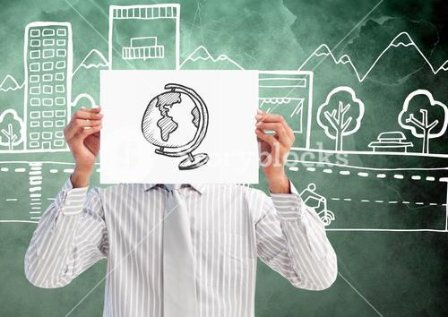 Man holding sheet of paper with drawn globe in front of his face and graphics in background