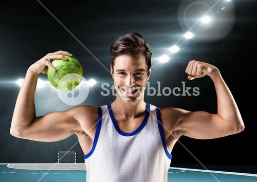 Portrait of man holding a handball and flexing muscles