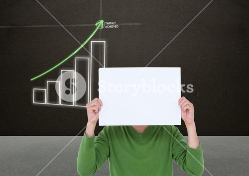 Woman holding blank sheet of paper in front of her face with bar chart in background