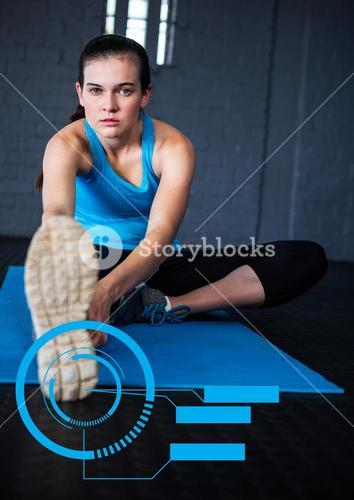 Portrait of woman exercising on mat