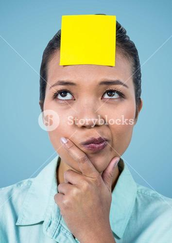Confused woman with blank sticky note on her forehead