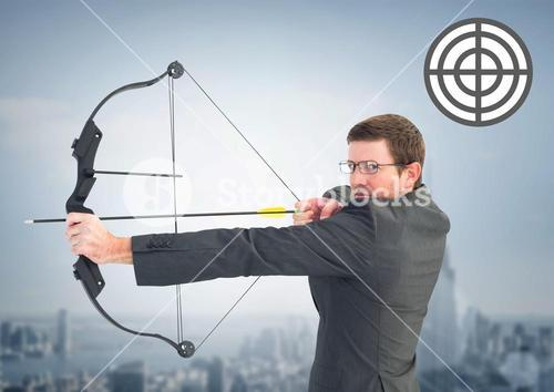 Portrait of businessman aiming with bow and arrow