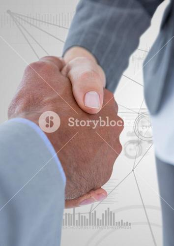 Business professionals shaking hands on technology background