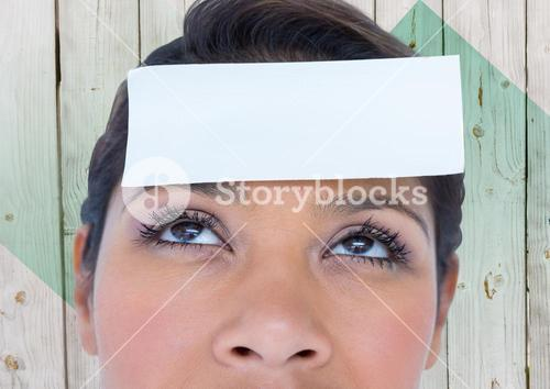 Woman with placard on forehead against wooden background