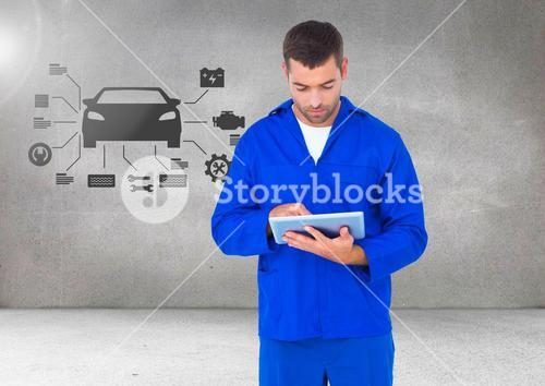 Mechanic using digital tablet against car mechanic interface in background
