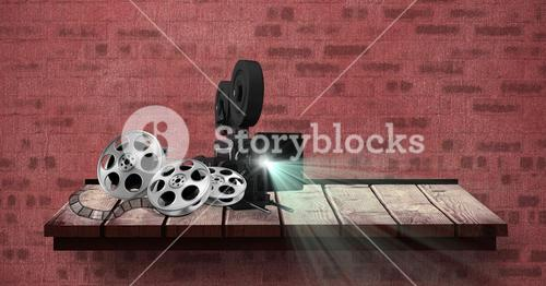 Film projector with reel placed on table against red bricked wall