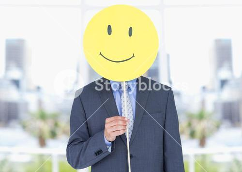Businessman holding a smiley