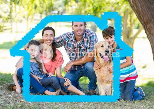 Family with dog sitting in the park with home outline