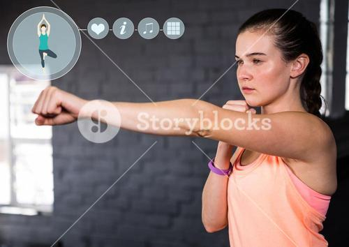 Fit woman practicing with fitness interface
