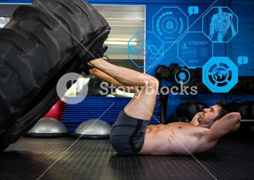 Fit man performing leg press exercise in gym
